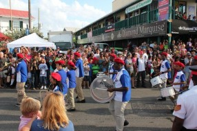 Students play steel drums at Pirates Week Parade