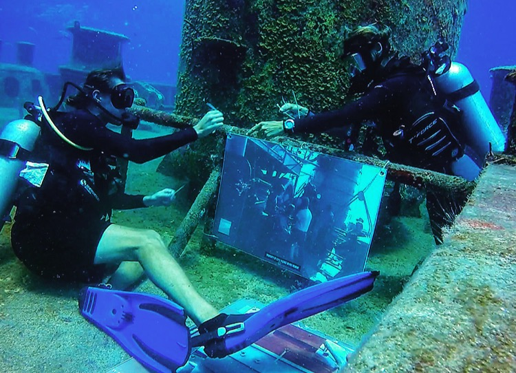 Stephen Aynsley from Divers Down mounts one of the underwater photos with an intern