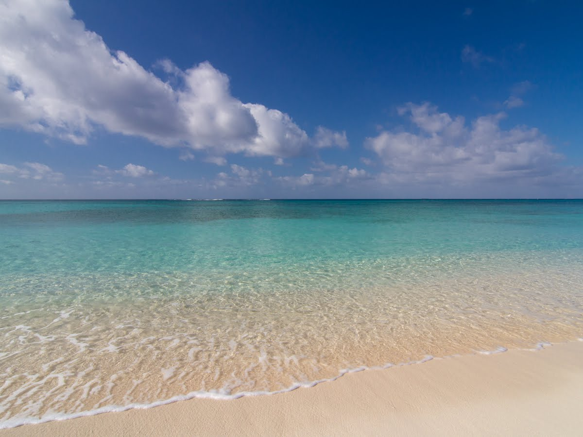 Of The Beach Is Captioned With So What If It S More Like Six Miles Long There A Reason Almost All Grand Cayman Top Resorts Are On Seven Mile